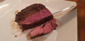 cutting the steak